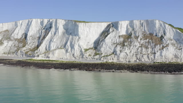 White Cliffs of Dover Aerial shot of the white cliffs and blue sea cliffs stock videos & royalty-free footage