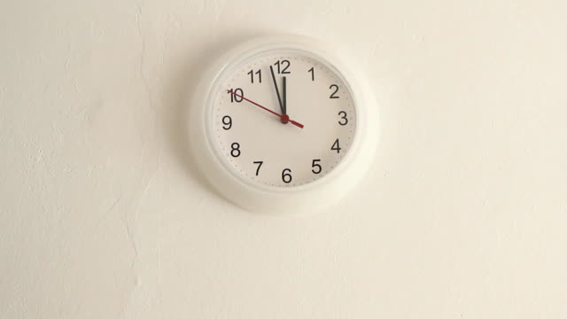 White clock hanging on wall ticking, full HD Midday. White clock hanging on wall ticking. Full HD with motorized slider. 1080p. midday stock videos & royalty-free footage