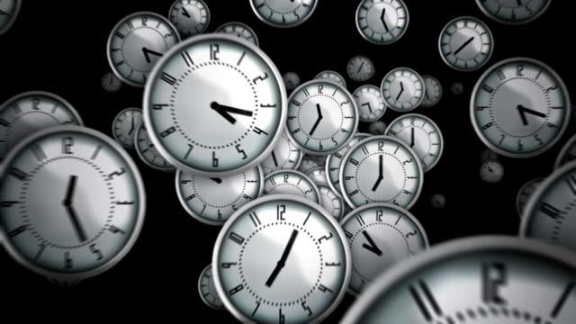White clocks flying. Black background. Loopable. video