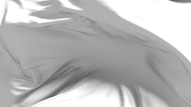 White cloth or silk flag waving at wind in slow, loop