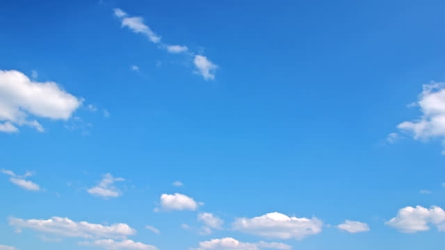 White clouds flying on blue sky - motion background time-lapse video