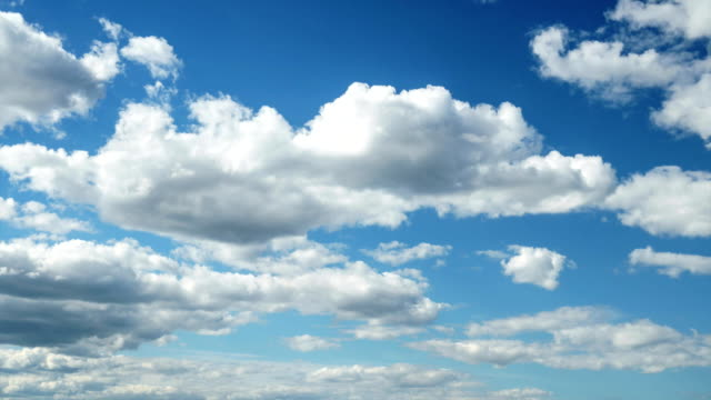 White clouds in the blue sky. Cloudscape motion freedom. Energy clouds timelapse