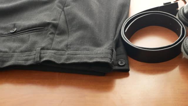 vit krage, kontorsarbetare kläder plagg set-par byxor byxor, bälte och svart formella skor. panorama 4k videofilmer - byxor bildbanksvideor och videomaterial från bakom kulisserna