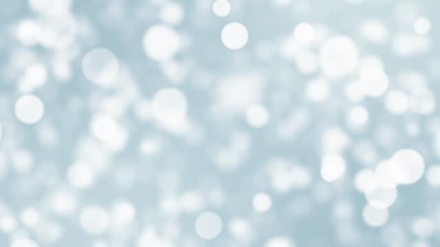 vídeos de stock, filmes e b-roll de partículas de cor branca. vídeo 4k. - brilhante luminosidade