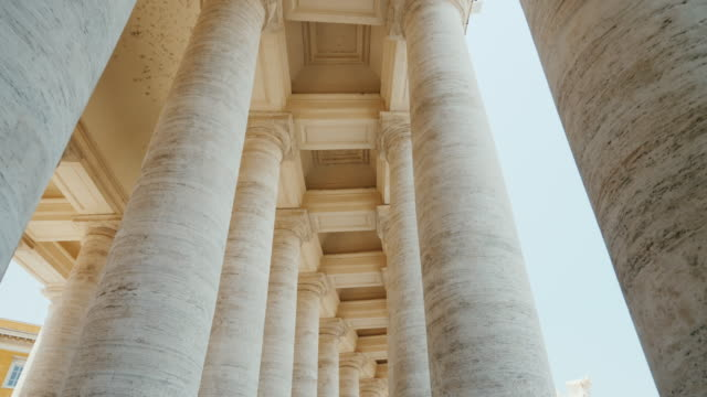 white columns of st. peter's church, the vatican city. piazza san pietro, rome, italy. pov video - italian architecture stock videos & royalty-free footage