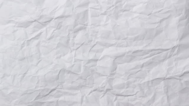 White crumpled paper background texture. Stop motion animation. Seamless looping.