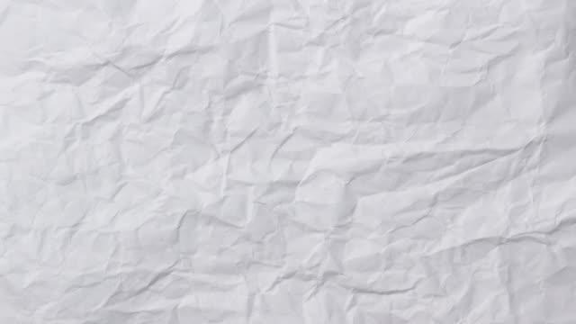 vidéos et rushes de texture de fond de papier froissée blanche. animation stop motion. boucles transparentes. - en papier
