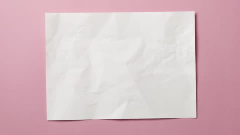 White crumpled paper texture on light blue or pink background. Stop motion animation. Seamless looping background. You can combine this clip with paper balls and icons to make a message or tale, see more options in my profile. art and craft stock videos & royalty-free footage