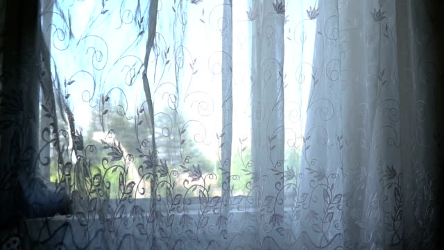 White curtains moving from wind Bright interior, window with curtains, white window sill, room tulle netting stock videos & royalty-free footage