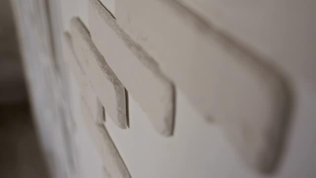 White decorative bricks on the wall close-up.