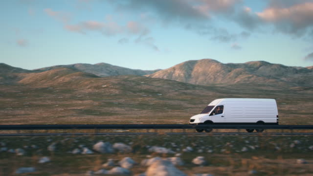 white delivery van driving along a desert road into the sunset Side-view camera follows a white delivery van driving along a desert highway into the sunset. Realistic high quality 3d animation. vänskap stock videos & royalty-free footage