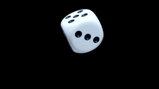 White dice on a black background video