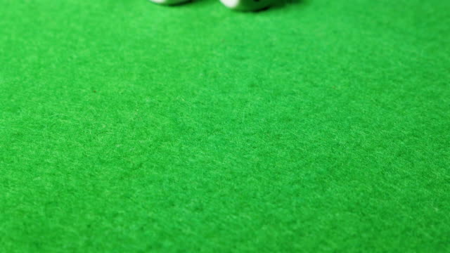 White dices on green cloth background. Dolly shot. Double six. video