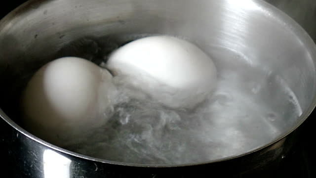 White eggs - cooked in a saucepan video