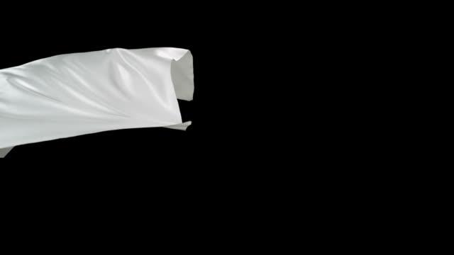 ホワイトの生地にブラックのバックグラウンドに流れるような、slow motion (スローモーション) - 布点の映像素材/bロール