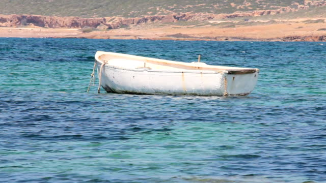 White fishing boat bobbing around off the Cyprus coast video
