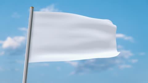 White flag waving. Luma matte provided so you can put your own background. White flag waving. Luma matte provided so you can put your own background. flag stock videos & royalty-free footage