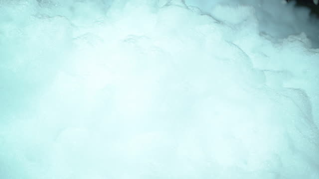 White foam from soap blowing in air