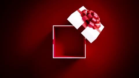 vidéos et rushes de blanc cadeau boîte ouverture sur fond rouge en résolution 4 k - cadeau
