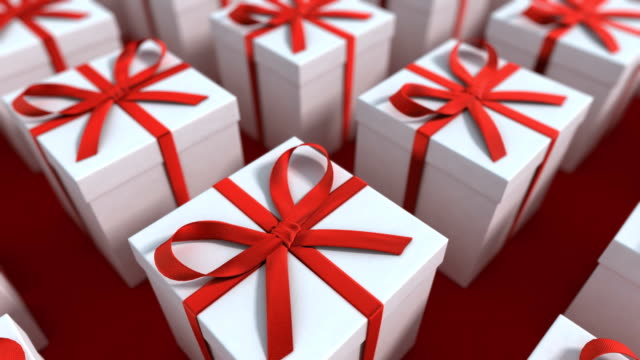 White gift boxes with red ribbon. Loopable video