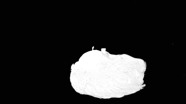 White Ink Drop Over Wet Black Screen Background Stock Video