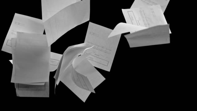 SLO MO White invoice sheets colliding on black background video
