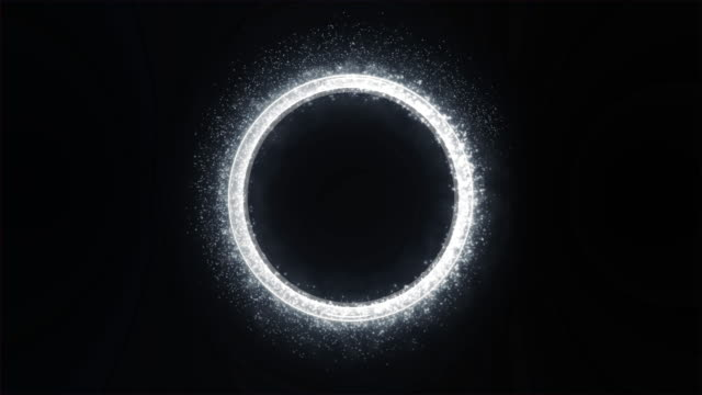 White Light with Sparkle and Smoke Trail Creates a Round Metallic Three-dimensional Ring. Black Background. video