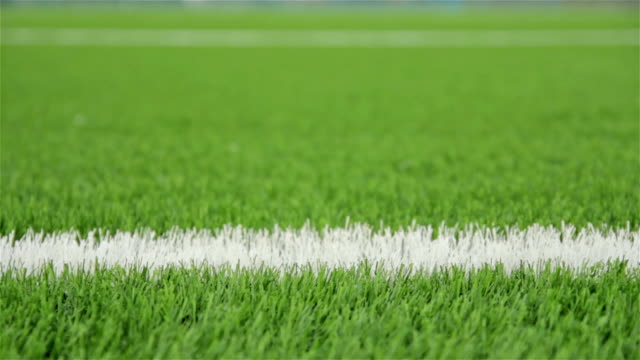 white line of the soccer field. close-up horizontal slider shot - grass stock videos & royalty-free footage