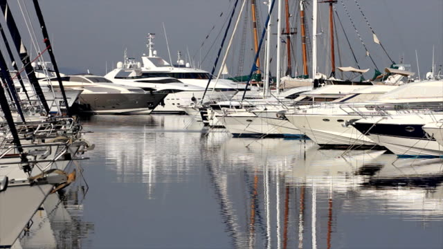 White luxury yachts at mediterranean harbor video