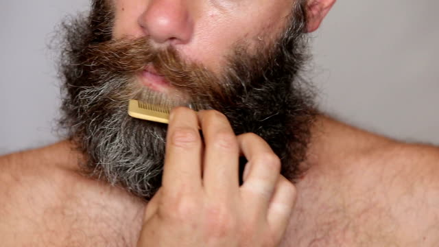White Man Taking Care of his Lush Beard and Mustache