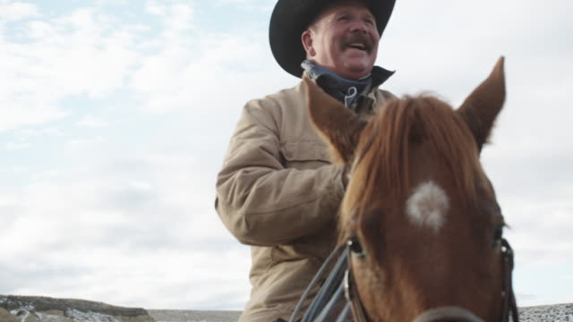 white middle-aged cowboy smiling - rancher video stock e b–roll