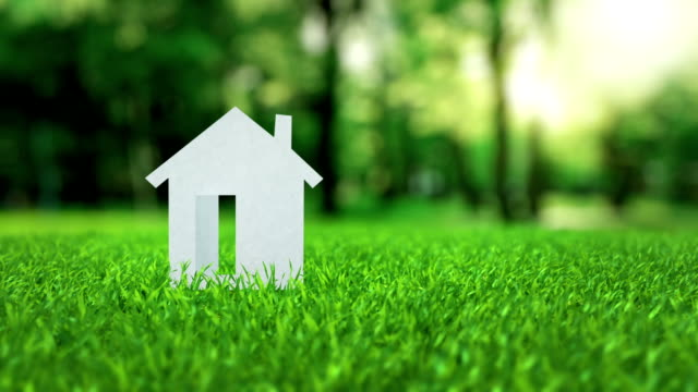 White paper house animation on green nice summer grass mortgage concept video