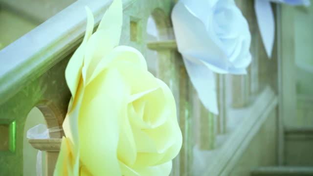 White paper rose on railing video