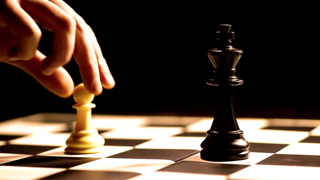 White pawn moves White pawn moves in a chess game. rivalry stock videos & royalty-free footage