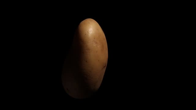 white potato rotating on black background white potato rotating on black background side lit stock videos & royalty-free footage