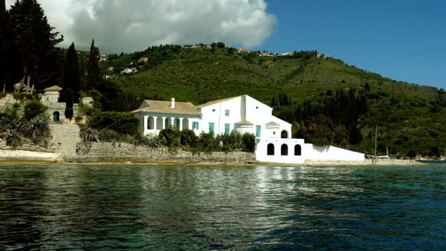 White private house on the rocky Mediterranean coast. Greece. Slow motion. HD