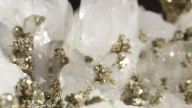MACRO DOF White quartz with metallic pyrite shining like ice under bright lights video
