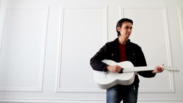 white quitar performer video