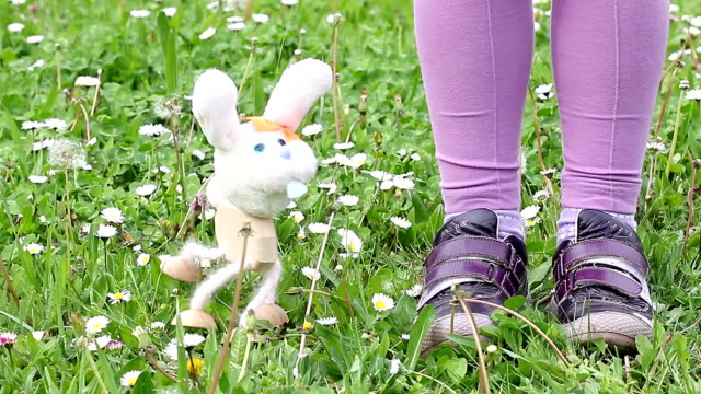 white rabbit marionette dancing on green grass white rabbit marionette dancing on green grass marionette stock videos & royalty-free footage
