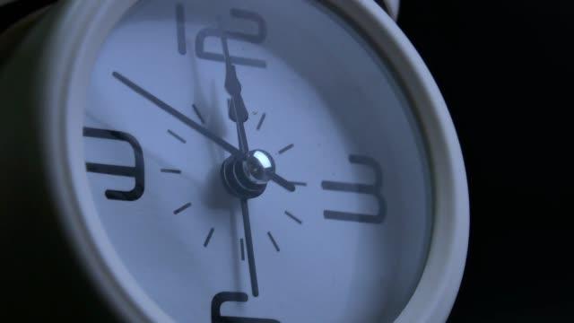 white retro alarm clock show time near midnight - promemoria video stock e b–roll