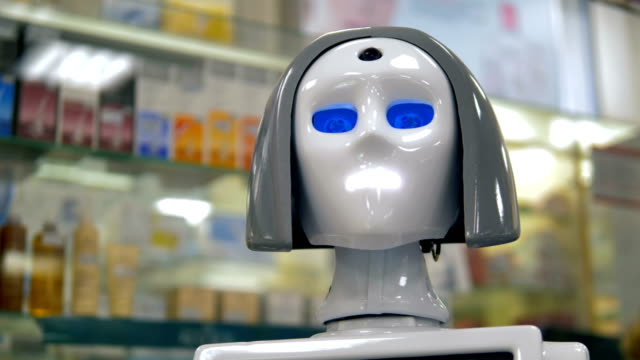 A white robots head during its work at a drugstore. video