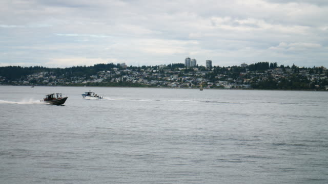 White Rock British Columbia Canada Background Waterfront View Crabbing Boats Speeding Across Water video