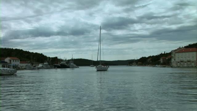White sailer sailing in sea video