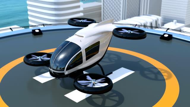 selbstfahrender passagier drohne start vom helipad weiß - luftfahrzeug stock-videos und b-roll-filmmaterial