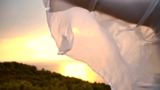 SLO MO White shawl fluttering in the wind video
