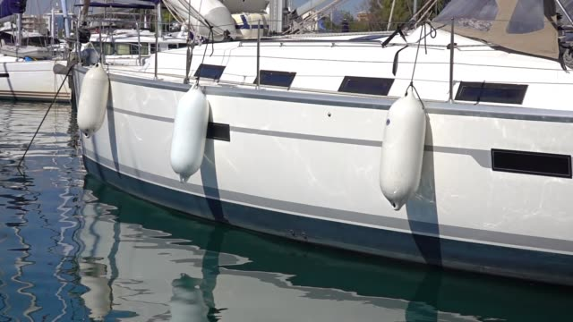 white side of the yacht and fenders. slow motion - passenger craft stock videos & royalty-free footage