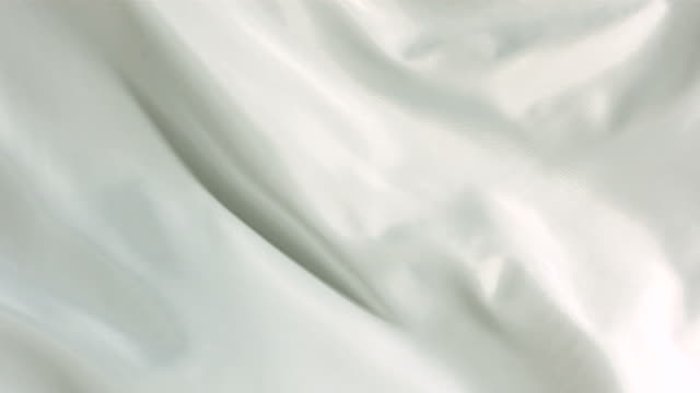White silk fabric blowing in the wind, abstract background video