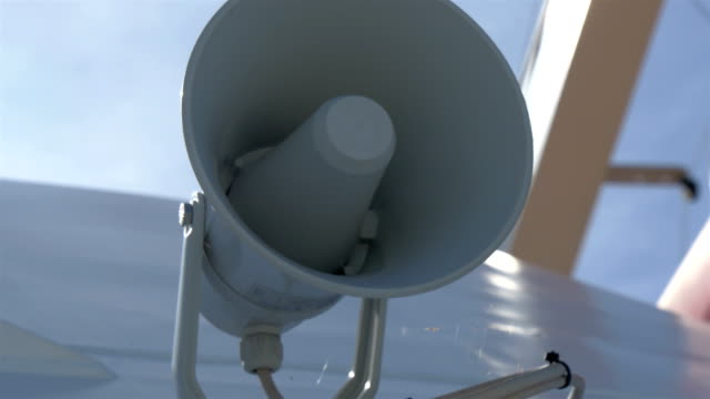 A white small megaphone attached on the yacht GH4 4K video