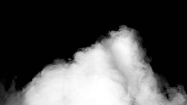 white smoke covers a black screen - matte stock-videos und b-roll-filmmaterial