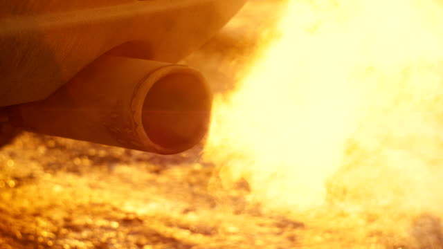 White smoke from the exhaust pipe of the car. video